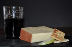 Cheese - Fontina Fontal Cheese. Fontina Fontal Cheese with crackers and apple slice.  Glass of wine to complete. Pictured on piece of black slate Stock Photos