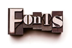 Fonts. The word Fonts done in letterpress type. Hand tinted for an antique look royalty free stock photo