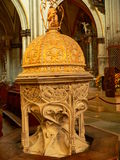 Fonts baptismaux, Cathedrale Saint-Nicolas de Fribourg ( Suisse ). The baptismal font, a masterpiece of Gothic sculpture were made between 1498 and 1499 Stock Photography
