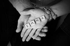 Fonts. Emma fonts in the arms royalty free stock image