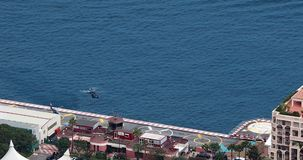 Helicopter Landing In Monaco Heliport. Fontvieille, Monaco - May 18, 2018: Aerial View Of Helicopters Outside At The Heliport, Helicopter Landing In Monaco stock video footage
