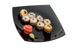 Food. Sushi on a black plate Royalty Free Stock Image