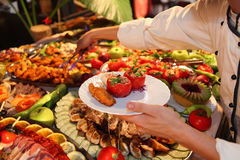 Food. Cook with a table full of food Royalty Free Stock Images