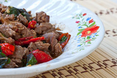 Food. Stir basil with meat in dinner Stock Photo