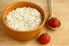 Food. A bowl of oatmeal on wooden background Royalty Free Stock Images