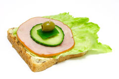 Food. Toast/sandwich with lettuce, ham, cucamber, paprika and olive Royalty Free Stock Photo
