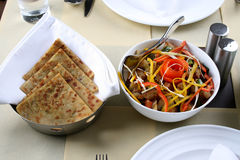 Food. Traditional indian food of stuffed paranthas and mix vegetables Stock Photo