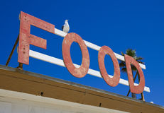 Food. Sign with seagull at Malibu beach, California Stock Photography