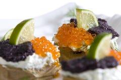 Food. Roasted potatoes wth caviar and lime Stock Photo