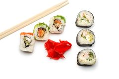 Food abstract background. On the white plane lie rolls or sushi, ginger plates and sticks for sushi. stock images