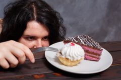 Food addiction, diet, dieting, unhealthy junk food concept. Youn stock photography