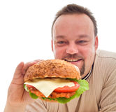 Food addiction - man in denial phase Stock Image