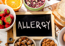 Food allergy. Allergic food on wooden background. Top view stock photography