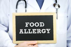 Food Allergy diagnosis message. On chalkboard by a doctor stock photo