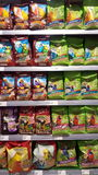 Food for animals, birds. Shelving in the store. Many packs of food for birds in a pet store. Location: Ferrara, Italy Stock Photo
