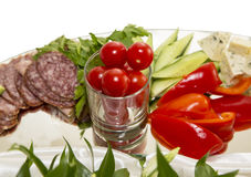 Food. appetizer. Beautifully laid appetizer of sausage, vegetables and cheese on a tray royalty free stock images