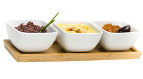 Food - appetizers. Appetizers - tapenade, hummus and zacusca isolated on white Royalty Free Stock Photo