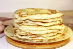 Food. Appetizing baked, thick yeast pancakes are stacked on a pl royalty free stock images