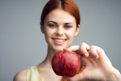 Food, apple, diet, healthy food, woman with apple on gray background Stock Photo