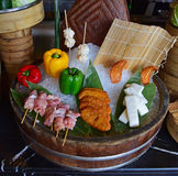 Food arrangement for presentation at a hotel buffet restaurant. The presentation consists of bell pepper, raw meat stick and vegetarian/meat paste on top of Stock Photos