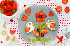 Food art idea for kids - bird pancakes with strawberry kiwi blue. Food art idea for kids - bird pancakes on strawberry kiwi blueberry flower royalty free stock photography