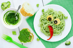 Food art idea for kids green monster from spaghetti, olives and Stock Images