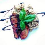 Food. Backed pork with buckweat, basilic and balsamic stock photography