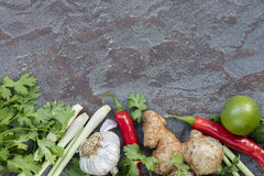 Food Background Asian Ingredients Top View on Slate. Food background with Asian ingredients, top view, over slate Stock Image