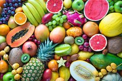 Assortment of colorful ripe tropical fruits. Top view. Food background. Assortment of colorful ripe tropical fruits. Top view royalty free stock photography