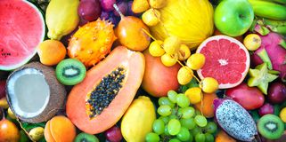 Assortment of colorful ripe tropical fruits. Top view Royalty Free Stock Images