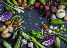Food background. Assortment of fresh garden vegetables. Top view. Free space for text Stock Photos