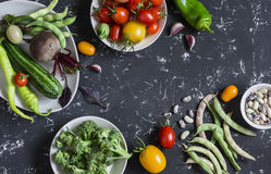 Food background. Assortment of fresh vegetables on a dark background. Top view Stock Images