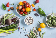 Food background. Assortment of fresh vegetables - tomatoes, beets, zucchini, broccoli, beans on a blue background. Stock Images