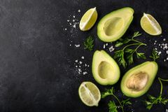 Food background with avocado, lime and parsley royalty free stock photo