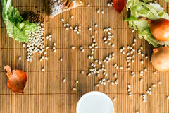 Food background on a bamboo Mat. Food background with cereals, bread and greens on a bamboo Mat Stock Photo
