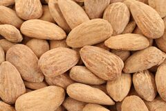 Free Food Background - Big Shelled Roasted Salted Almonds Situated Arbitrarily Stock Photos - 185493413
