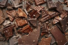 Food background from chocolate slices.Top view. Food background from chocolate slices on a dark slate, stone or metal background.Top view Royalty Free Stock Photo