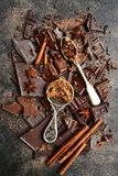 Food background from chocolate slices and spices.Top view. Food background from chocolate slices and spiceson a dark slate, stone or metal background.Top view Royalty Free Stock Images