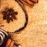 Food background with copy space. Brown sugar, anise star and cinnamon sticks on wooden background close up, still life. stock photography