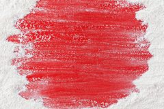 Food background with copy space - flour brushed away on red table stock photo