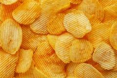 Food background of corrugated potato chips stock photos