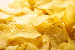 Food background of delicious chips. Corrugated golden chips potato texture royalty free stock image