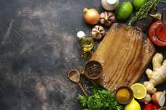Food background with empty wooden cutting board and ingredient f stock image