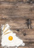 Food background Flour egg wooden texture. Food background. Flour and egg on wooden texture Royalty Free Stock Photo