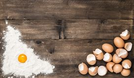Food background Flour eggs wooden kitchen table. Food background. Flour and eggs on wooden kitchen table Stock Image