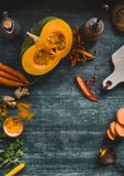 Food background frame with pumpkin and orange color vegetables on kitchen table, top view. Place for your design. Menu and recipes royalty free stock photography