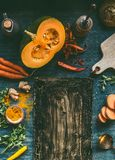 Food background frame with pumpkin and orange color vegetables on kitchen table, top view. Place for your text, design , menu or royalty free stock photo
