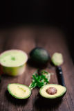 Food Background with fresh organic avocado on old wooden table Royalty Free Stock Photo