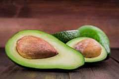 Food background with fresh organic avocado on old wooden table, Royalty Free Stock Photo