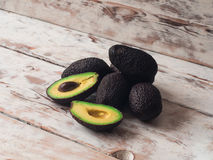 Food background with fresh organic avocado on old wooden table, side view, copy space Stock Photography